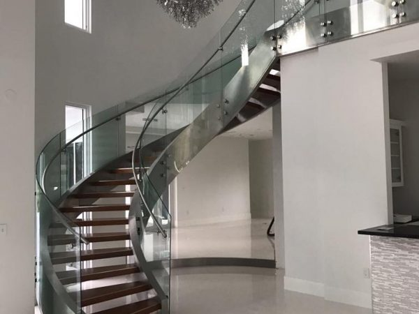 Helicoidal Stainless Steel Stair + Curved Glass Railings - Sunny Isles Beach, Florida